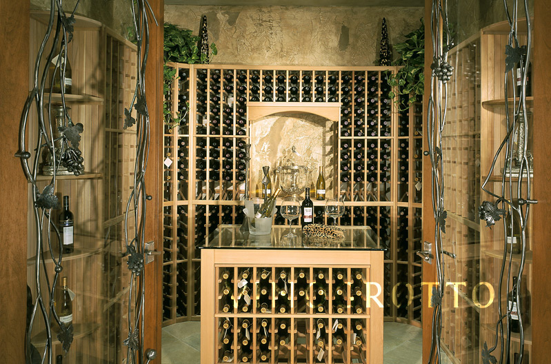 Custom wine cellar with wrought iron grapevine doors